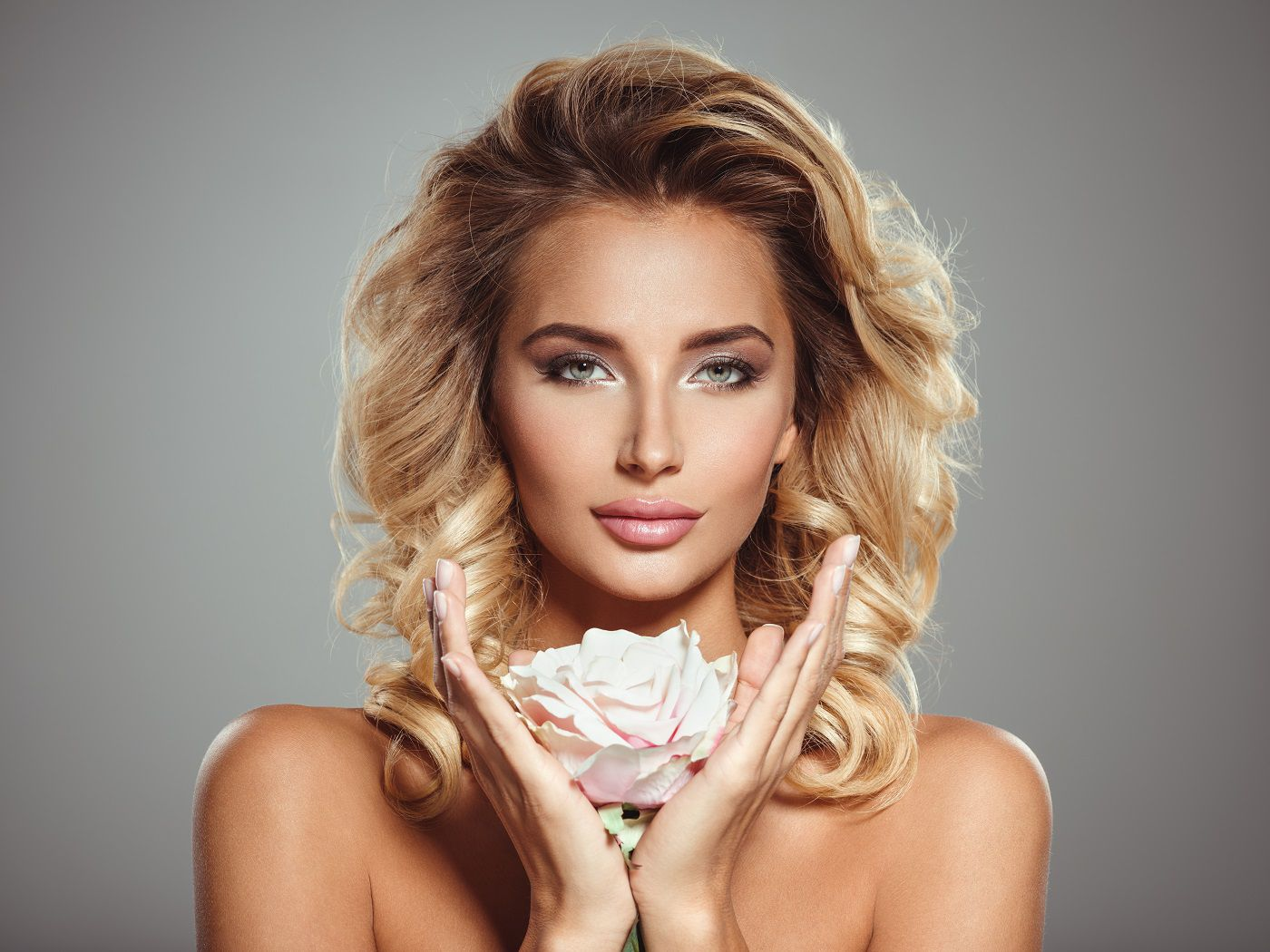 diamond-face-photo-beautiful-blond-woman-with-flower-closeup-attractive-sensual-face-white-woman-with-curly-hair-smokey-eye-makeup.jpg