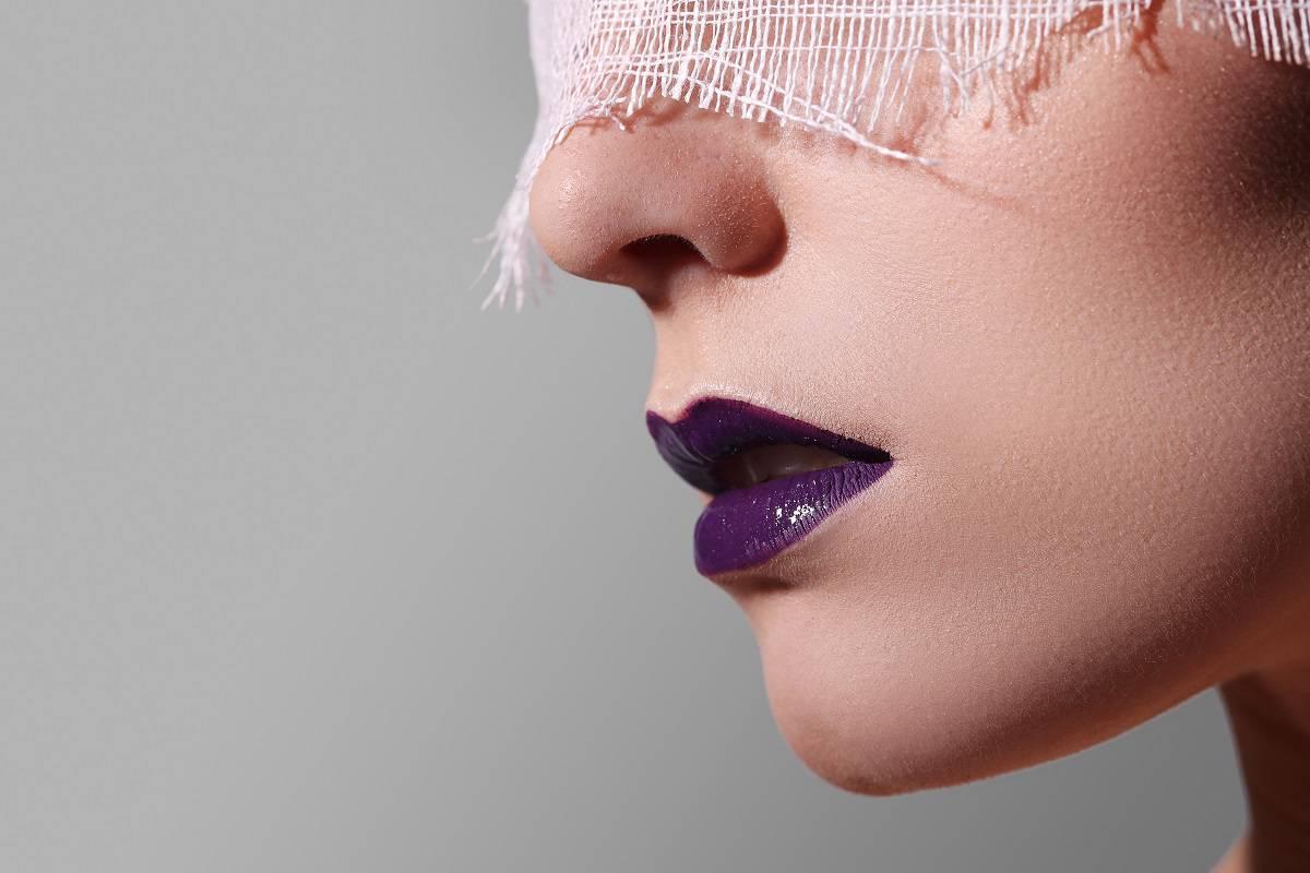 Fashion, bizarre. Woman with purple lipstick