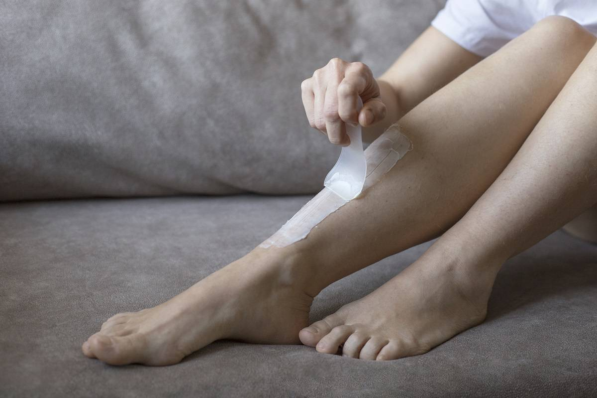 female-legs-with-depilation-cream-close-up-legs