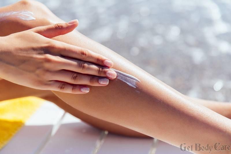close-up-view-female-hand-applying-sunscreen-her-leg-near-sea.jpg