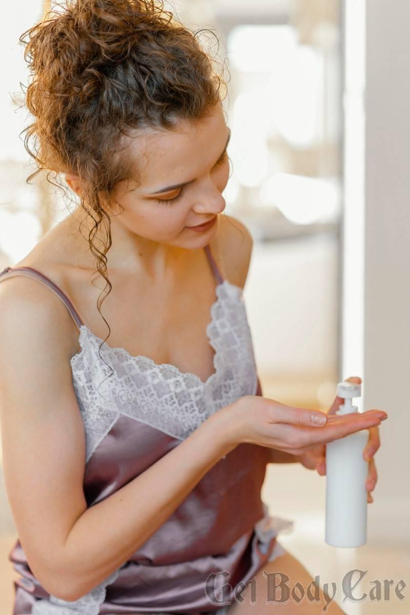 woman-pijama-applying-lotion.jpg