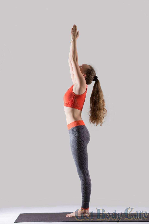 young-attractive-woman-standing-tadasana-pose-grey-studio-ba.jpg