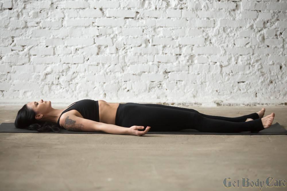 young-yogi-attractive-woman-savasana-pose-white-loft-backgro.jpg