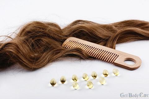 oil-capsules-with-vitamin-e-lie-brown-hair-curls.jpg