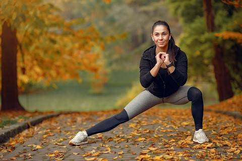 sports-girl-black-top-training-autumn-park.jpg