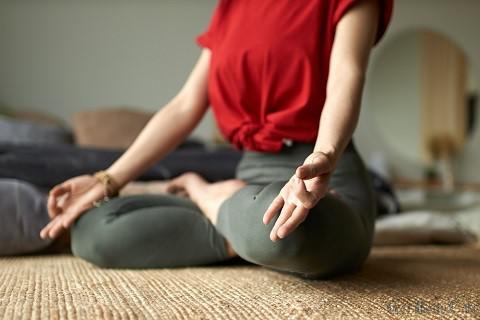 young-woman-doing-yoga-lotus-position-home.jpg